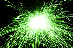 Beautiful green sparkler on black background Royalty Free Stock Images