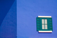 Beautiful green window on blue wall Stock Photography