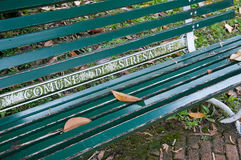 Beautiful green wooden bench with the inscription Stock Photos