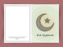 Beautiful greeting card for Eid Mubarak celebration. Stock Photos