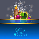 Beautiful greeting card with gift boxes. And candles for celebration of Muslim community festival Eid Mubarak. EPS 10 Stock Photos