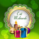 Beautiful greeting card with gift boxes. And candles for celebration of Muslim community festival Eid Mubarak. EPS 10 Stock Image