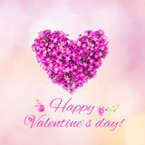 Beautiful greeting card Happy Valentines Day. Arrangement of small pink flowers in the shape of a heart on soft light pink background. Top view. Holiday Square Stock Photos