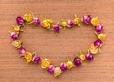 Beautiful greeting card of Valentine with dried roses on wooden Stock Photography