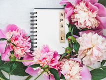 Beautiful greeting card with the word APRIL stock images