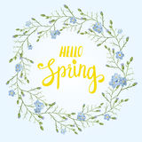 Beautiful greeting card with a wreath of spring blue flowers with lettering on blue background. Vector illustration Stock Images
