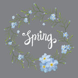 Beautiful greeting card with a wreath of spring blue flowers with lettering on grey background. Vector illustration Stock Image