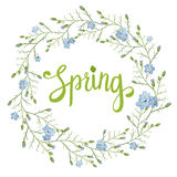 Beautiful greeting card with a wreath of spring blue flowers with lettering on white background. V Stock Photo