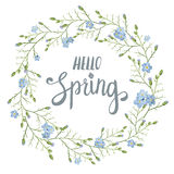 Beautiful greeting card with a wreath of spring blue flowers with lettering on white background. Vector illustration Stock Photography