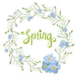 Beautiful greeting card with a wreath of spring blue flowers with lettering on white background. Vector illustration Royalty Free Stock Photos