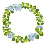 Beautiful greeting card with a wreath of spring blue flowers. Vector illustration Stock Images
