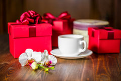 Beautiful greeting universal concept with red boxes, orchid flow Royalty Free Stock Photos