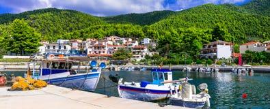 Beautiful gren Skopelos island- traditional fishing village Neo Klima. Northen Sporades of Grece stock images