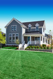 Beautiful Grey Cape Cod Style Home. With a large front porch Stock Photo
