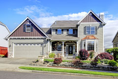 Beautiful Grey New Classic Home Exterior With Natural Stone. Royalty Free Stock Photography