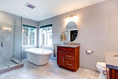 Beautiful grey new modern bathroom interior. Royalty Free Stock Images