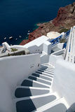 Beautiful grey and white steps and Aegean sea in Oia, Santorini, Royalty Free Stock Photography