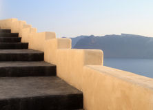 Beautiful grey and yellow unique steps and Aegean sea in Oia, Sa Royalty Free Stock Image