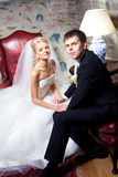 Beautiful groom and bride in interior Stock Image