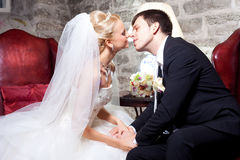 Beautiful groom and bride in interior Royalty Free Stock Photos