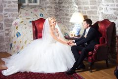 Beautiful groom and bride in interior Royalty Free Stock Images