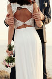 Beautiful groom and bride in wedding clothes posing on sea coast Stock Image