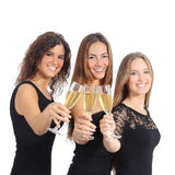 Beautiful group of three women toasting with champagne. Isolated on a white background Stock Images