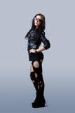 Beautiful grunge sexy woman in torn tights Stock Image