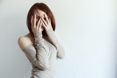Beautiful grunge woman covering face with palm Royalty Free Stock Photo