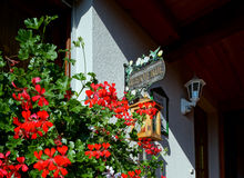 Beautiful guesthouse with terrace in Alsace, France. Alpine styl Stock Photos
