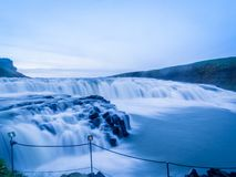 Beautiful Gullfoss waterfall at sunset in blue tones in rainy weather Iceland. Many jets of water form a beautiful cascade on river stock images
