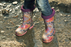 Beautiful gumboots in a puddle Royalty Free Stock Photos