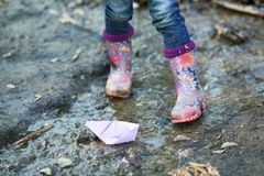 Beautiful gumboots in a puddle Royalty Free Stock Image