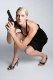 Beautiful Gun Woman. Beautiful blond gun woman royalty free stock photo