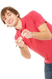Beautiful guy Peeps and points to you Stock Photography