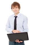 Beautiful guy running on a laptop, dressed in a shirt and tie Royalty Free Stock Photo