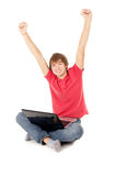 Beautiful guy sitting for the laptop and happy raising a hand in Royalty Free Stock Image