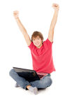Beautiful guy sitting for the laptop and happy raising a hand in Royalty Free Stock Photography