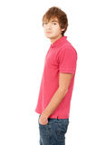 Beautiful guy is standing sideways to the camera Stock Photo