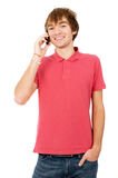 Beautiful guy is standing and talking on a mobile phone Royalty Free Stock Photo