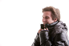 Beautiful guy in winter with anorak. Beautiful young man posing in winter with a warm anorak Royalty Free Stock Image