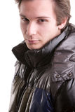 Beautiful guy in winter with anorak. Beautiful young man posing in winter with a warm anorak Stock Images