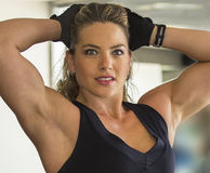 Beautiful Gym Rat. Israeli fitness model and trainer, Dana Shemesh, strikes a sultry pose at a gym in Ramat Gan, Israel.  Displaying her firm, defined, athletic Royalty Free Stock Images
