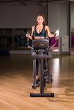 Beautiful gym woman exercising on a cardio machine Royalty Free Stock Photo