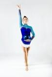Beautiful gymnast athlete doing exercise with ball. Isolated on Stock Image