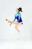 Beautiful gymnast athlete doing exercise with hoop. Isolated on Stock Photos