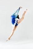 Beautiful gymnast athlete doing exercise. Isolated on white. Stock Images