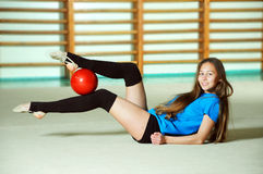 Beautiful gymnast with the ball Stock Photography