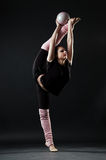 Beautiful gymnast with ball stock photography