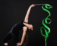 Beautiful gymnast with green ribbon Stock Image